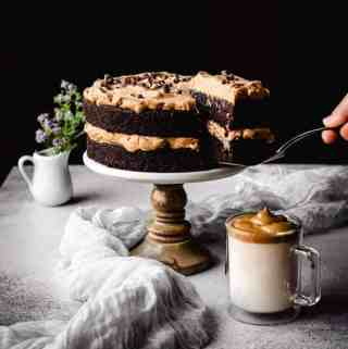 serving a slice of dalgona coffee chocolate cake