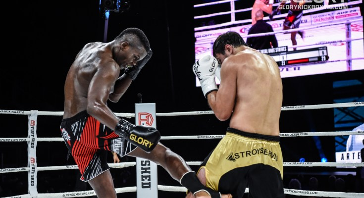 Danyo Ilunga lands a low kick on Artem Vakhitov