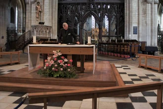 Anglican vicar at work Ely Cathedral