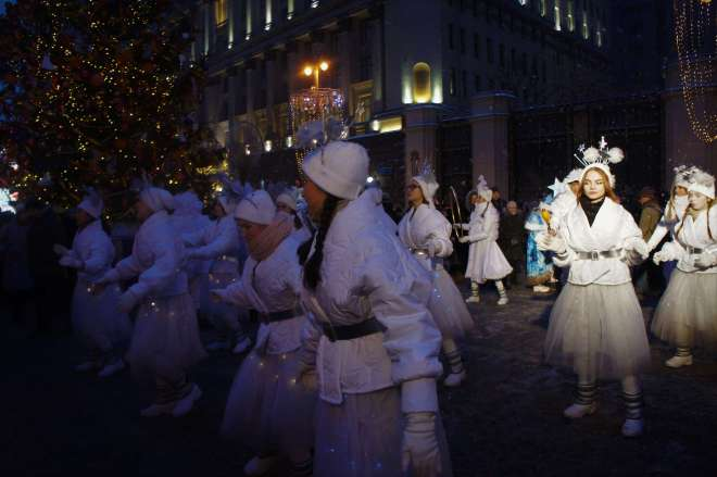 Dancing angels on Tverskaya Street for the Moscow New Year Street Party