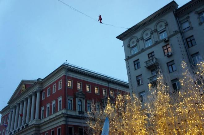 Tightrope walker on Tverskaya Street for the Moscow Journey into Christmas Festival