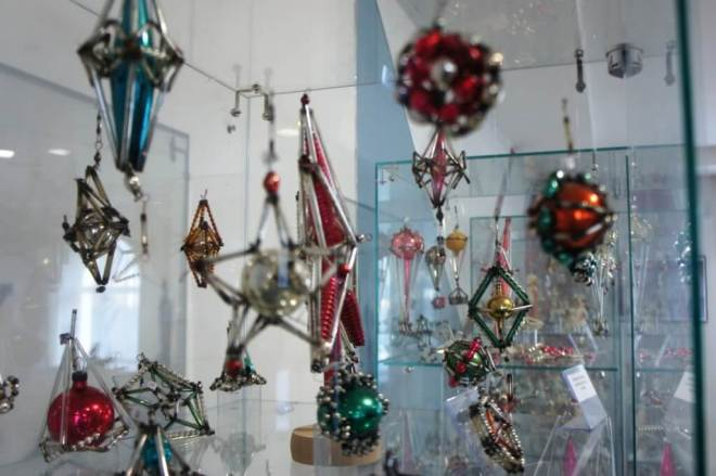 Vintage glass tree ornaments, mostly in the shape of stars