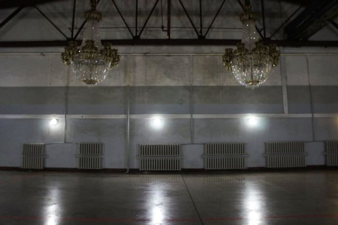 Empty room used as a film studio at MosFilm Stdio, apart from two chandeliers hanging from the ceiling
