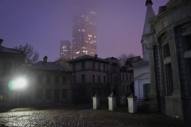 Set of old streets and buildings on the MosFilm Studio tour with a real modern highrise building in the background
