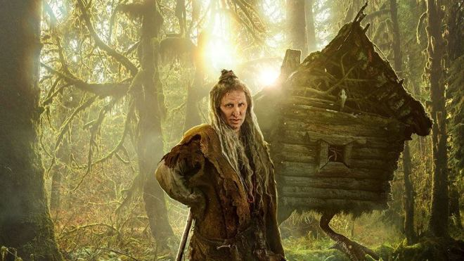 Baba Yaga, looking fabulous in front of the hut on chicken legs in the film the Last Bogatyr 2 Root of Evil