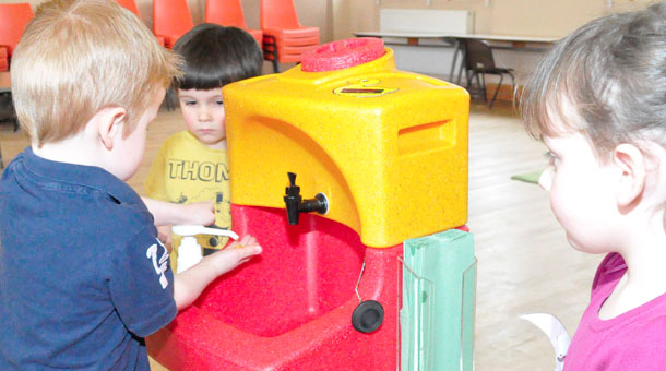 Nursery children learn important hand washing lessons