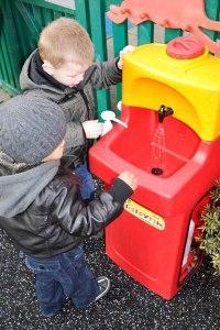 Children washing hands at nursery school