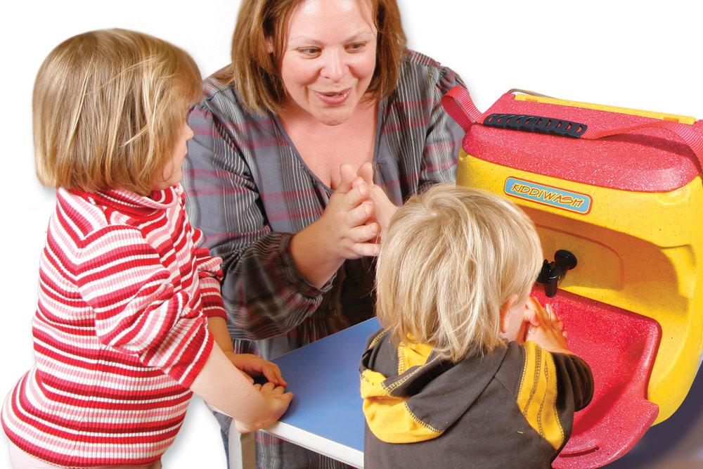 Teaching children to wash hands with a KiddiWash