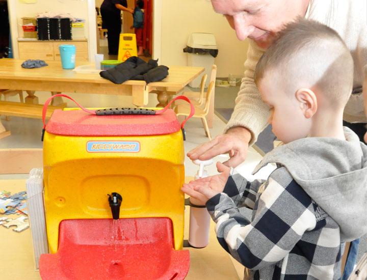 Infection prevention experts teach schoolchildren the importance of handwashing