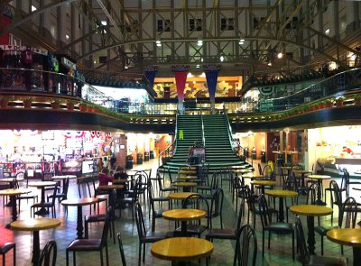 Go through the lower level food court to begin the tour