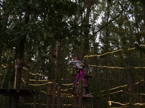 The forest lights up for evening climbs at the Adventure Park at Sandy Spring