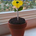 Great Mother's Day Idea! A flower lollipop in a pot of chocolate! Mom can use the lollipop to stir her coffee!