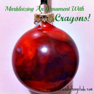 Marbleizing a clear ornament with broken crayons, and a hair dryer!