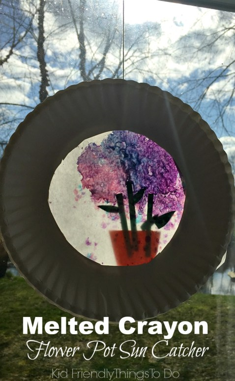 A Flower Pot Sun Catcher with Melted Crayons! Perfect for Mother's Day, spring and summer crafts - KidFriendlyThingsToDo.com