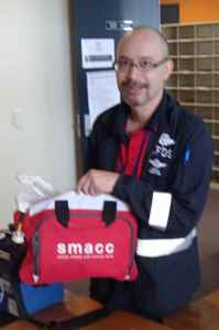 Minh demonstrates SMACC2013 conference bag as airway kit bag