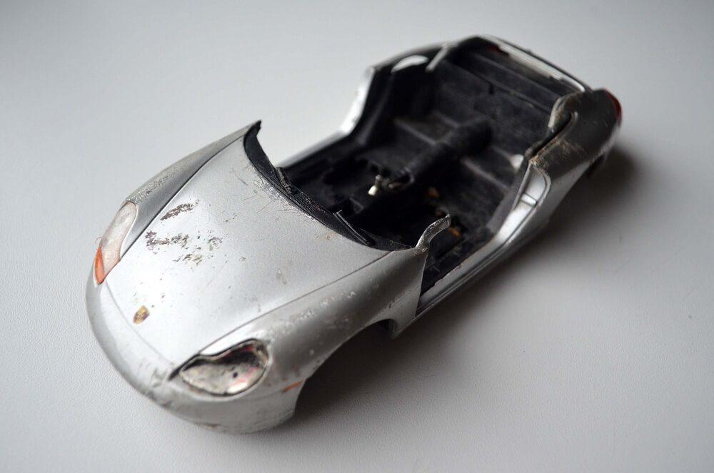 Completely broken Bburago Porsche in 1:24 scale with sharp edges