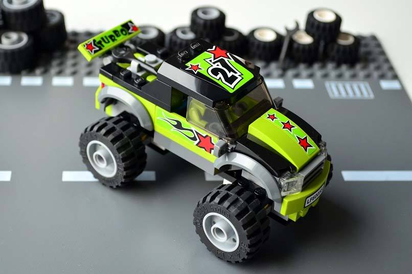 Lego Monster Truck parked on a lego road plate