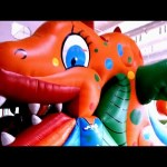 Indoor playground for kids with inflatable big fish. Funny video