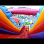 Outdoor playground fun for kids. Huge bouncy castle and water balls.