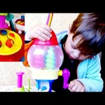 Play doh maker for kids. Two children make candy balls and   sweet  candy .