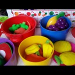 Toy cutting fruit playset for cooking in kitchen.