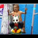 Outdoor playground fun for kids. Sliders, swings, trampoline carousel …