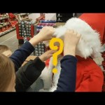 Preparation for Santa Claus. Children playing and looking for fun toys while shopping at CarreFour