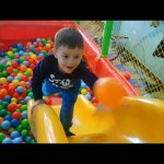 Playground fun for kids with pool balls, sliders, surprise toys. Video from KIDS TOYS CHANNEL