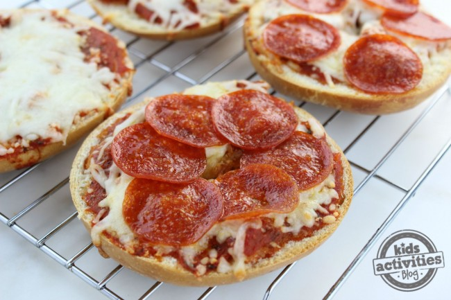 Pizza Bagels on a rack with cheese bagels too.