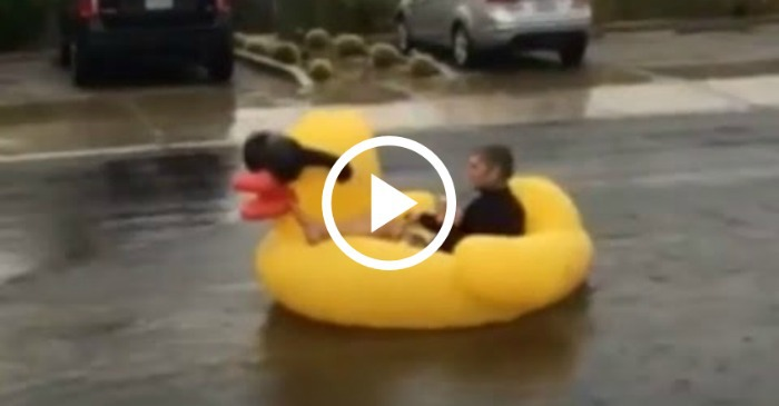 Man Rides Rubber Ducky Down Flooded Street In Palm Springs