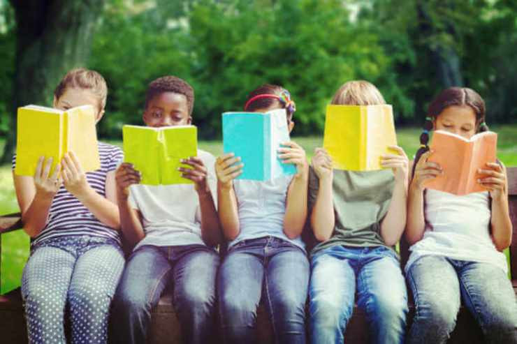 Children reading in the park-Kids Are A Trip