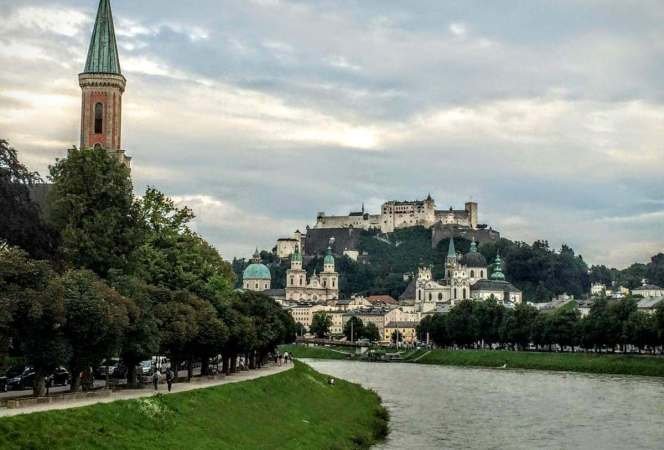 """The city might be known for its ties to the movie """"Sound of Music"""", but it has much more to offer. With music, parks, and entertainment galore, come see all the family friendly things to do in Salzburg before planning your next trip.-Kids Are A Trip"""