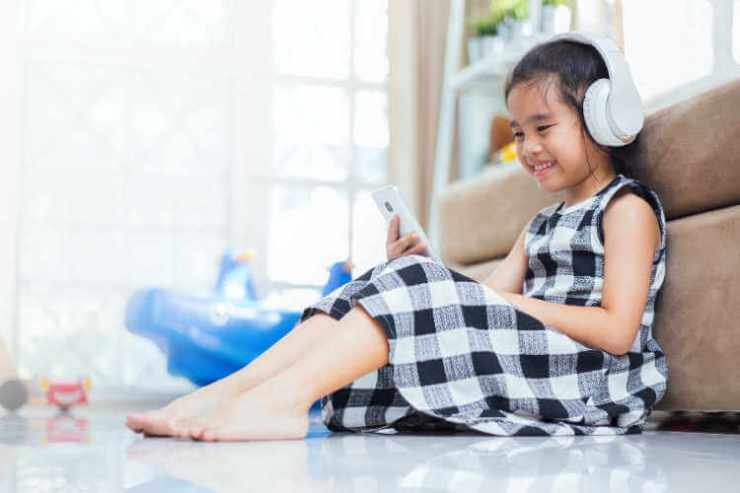Girl with headphones listening to music-Kids Are A Trip