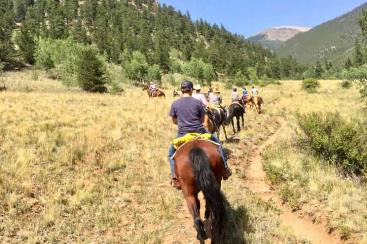 Dude ranch vacation horses mountains Colorado