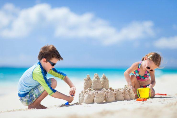 Kids building Sand castles on the beach