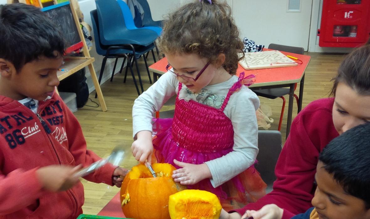 After School Club children pumpkin carving