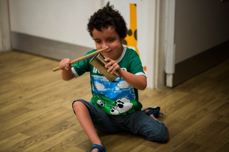 young person making music