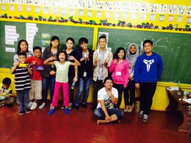Regie (Cream Jacket) Together with Camp 7 Dream Hub Learners and Student Volunteers