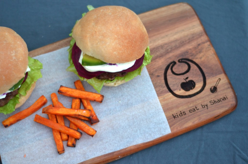 beef burgers with pickled beetroot and whipped fetta. An easy and healthy burger for a 'fast food' lunch or dinner. Made delicious with the sweetness and crunch of the pickled beetroot. http://kidseatbyshanai.com/beef-burgers-with-pickled-beetroot-whipped-fetta/ #healthykids #burgers #healthy #easy