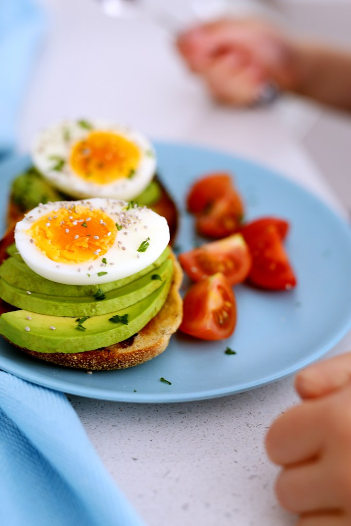 avocado and eggs on english muffins