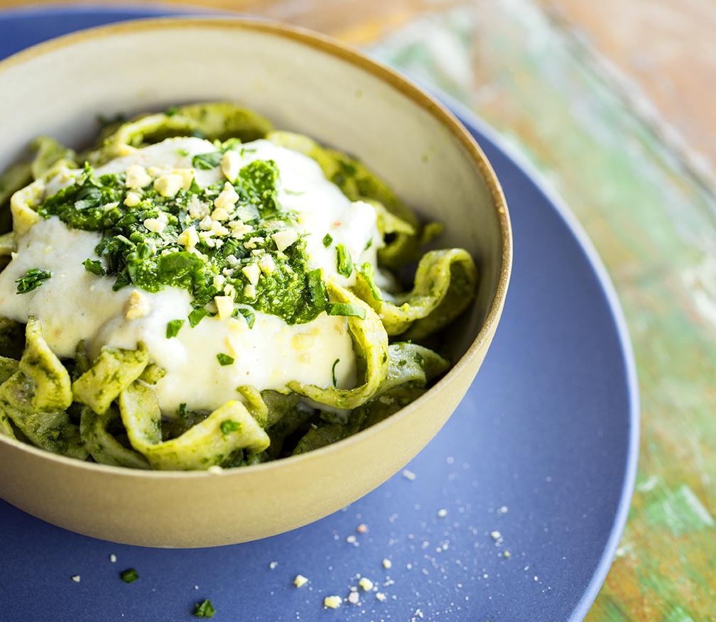 spirulina spaghetti with crunchy pesto and a creamy cauliflower sauce