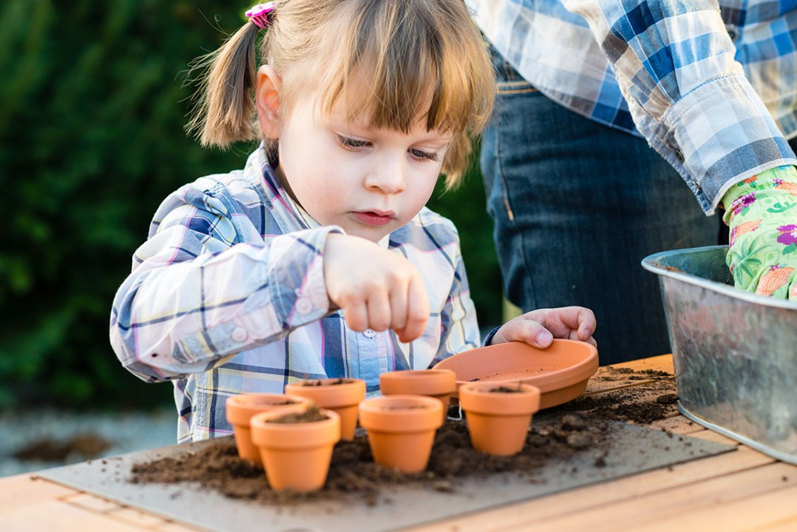Image result for child planting seeds