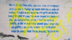 Image of graffiti of poem in blue writing on white background