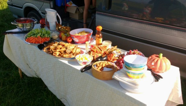 buffet-table-with-food-on-next-to-vehicle