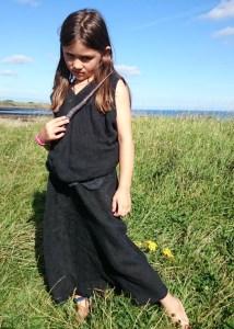 Image of girl-overlooking-sea-in-black-dress-bellatrix-lestrange-costume