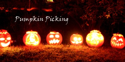Image of row-of-carved-pumpkins-lit-up-in-dark-with-banner
