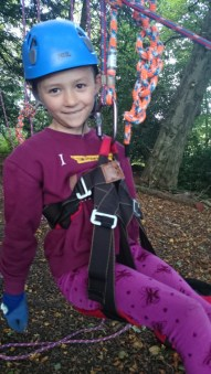 Image of close-up-of-girl-in-climbing-harness