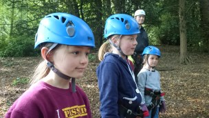 Image of close-up-of-three-girls-in-climbing-gear