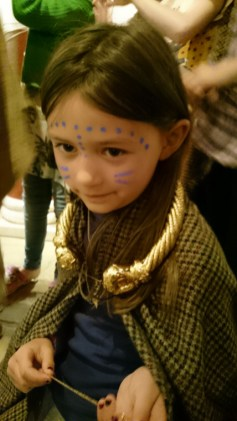 Image of girl-dressied in-woollen-robe-with-golden-necklace-and-woad-face-paints