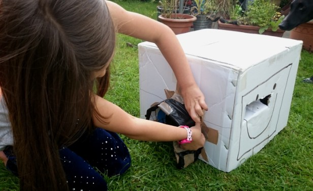 girl-making-a-cardboard-box-hedgehog-house